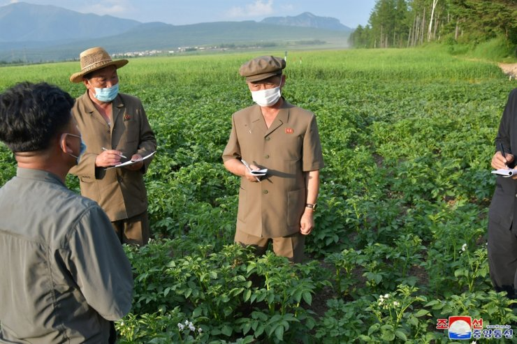 North Korea's Premier Kim Tok-hun makes field inspection visit to a rural area in Samjiyon, North Korea, in this photo released by North Korea's Korean Central News Agency on July 18. Yonhap
