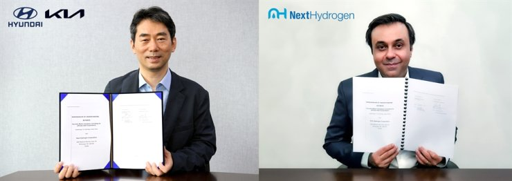 Oh Jae-hyuk, vice president and head of Energy Business Development at Hyundai Motor Group, poses with Raveel Afzaal, president and CEO of Next Hydrogen, after signing a partnership, in this photo provided by the Korean automaker, Friday. Courtesy of Hyundai Motor Group