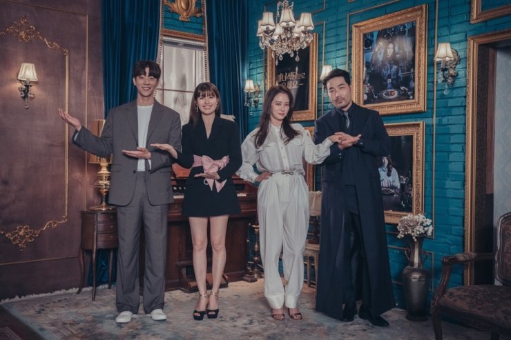 The cast members of 'The Witch's Diner,' from left, Chae Jong-hyeop, Nam Ji-hyun, Song Ji-hyo and Ha Do-kwon, pose for pictures during an online press conference for the series, Friday. Courtesy of CJ ENM