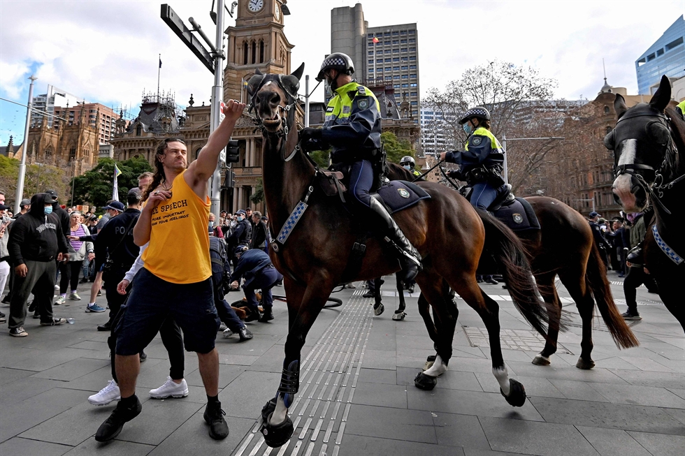 Thousands of anti-lockdown protestors take to the streets during a rally as they gathered to demonstrate against the city's monthlong stay-at-home orders, Sydney, Australia, July 24. AFP-Yonhap
