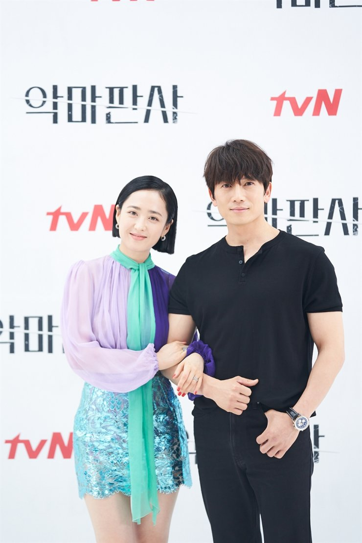 Actors Kim Min-jung, left, and Ji Sung pose for pictures during a media conference for the tvN series 'The Devil Judge,' Friday. Courtesy of tvN