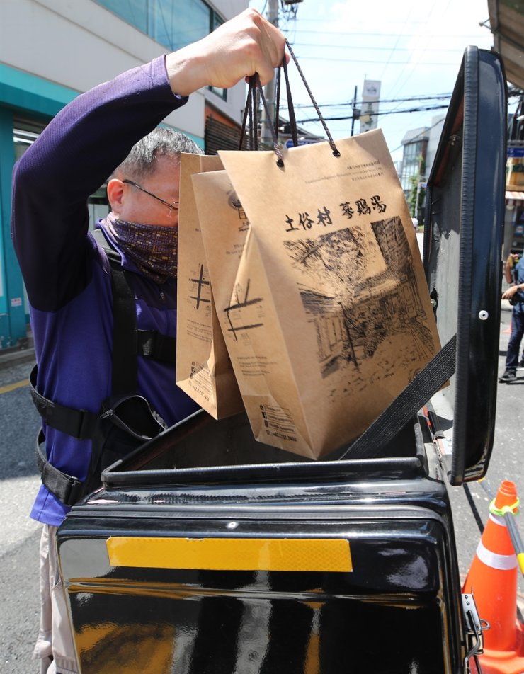 A delivery worker picks up
