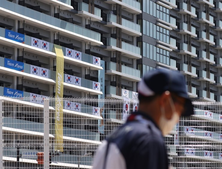 Korean Flags and signs hang on the apartment building housing Korea's Olympics team, at the Athletes Village in Tokyo, Saturday, ahead of the Games. Yonhap
