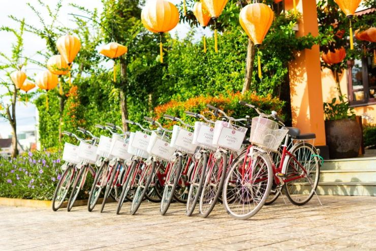 Bicycles are parked in front of Allegro Hoi An ― A Little Luxury Hotel & Spa, located in Hoi An, Vietnam. Courtesy of Booking.com