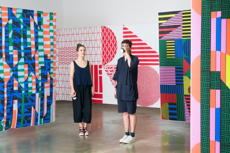 Loes van Esch, left, and Simone Trum of Dutch graphic design duo Team Thursday, who designed the 'Versatile Volumes' exhibition, which displays the 33 books that won the 'Best Dutch Book Designs' in 2019 at the KF Gallery in central Seoul. Courtesy of Team Thursday