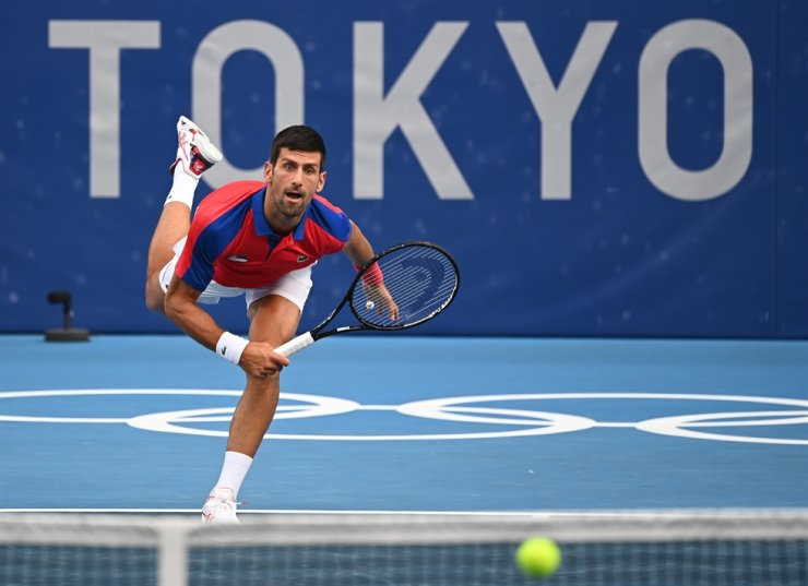 Novak Djokovic of Serbia serves during the men's singles second-round match against Jan-Lennard Struff of Germany at the Tokyo Olympic Games in Tokyo, Japan, Monday. Xinhua-Yonhap