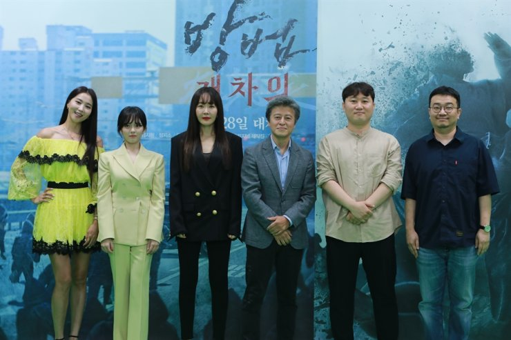 From left, actors Oh Yoon-ah, Jung Ji-so, Uhm Ji-won, Kwon Hye-hyo, director Kim Yong-wan and writer Yeon Sang-ho pose during a press conference for the film 'The Cursed,' Tuesday. Courtesy of CJ ENM