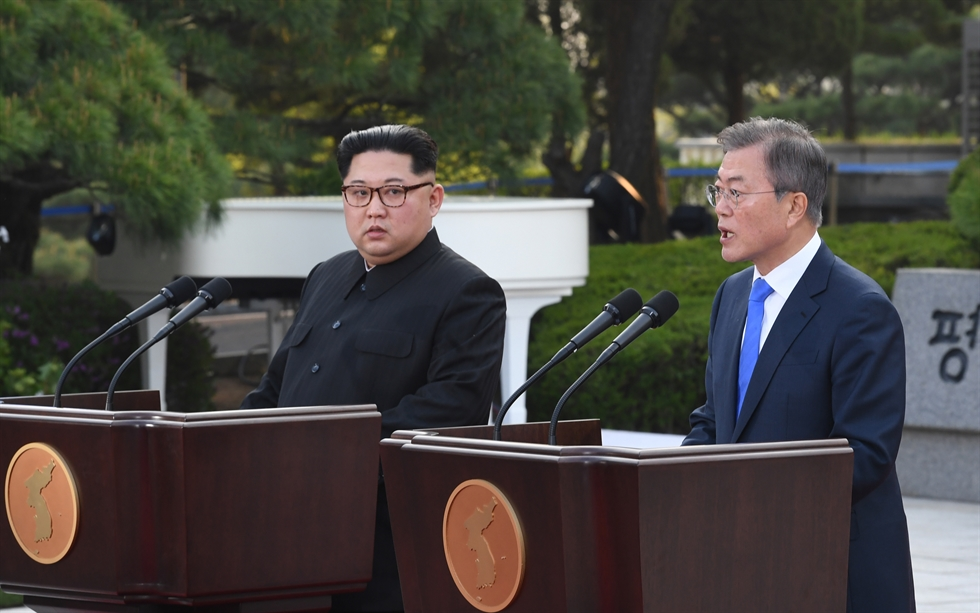 An official from South Korea's Ministry of Unification makes a call to his North Korean counterpart at the Seoul branch of the joint inter-Korean liaison office, Tuesday, after the two Koreas restored their lines of communication. Courtesy of Ministry of Unification