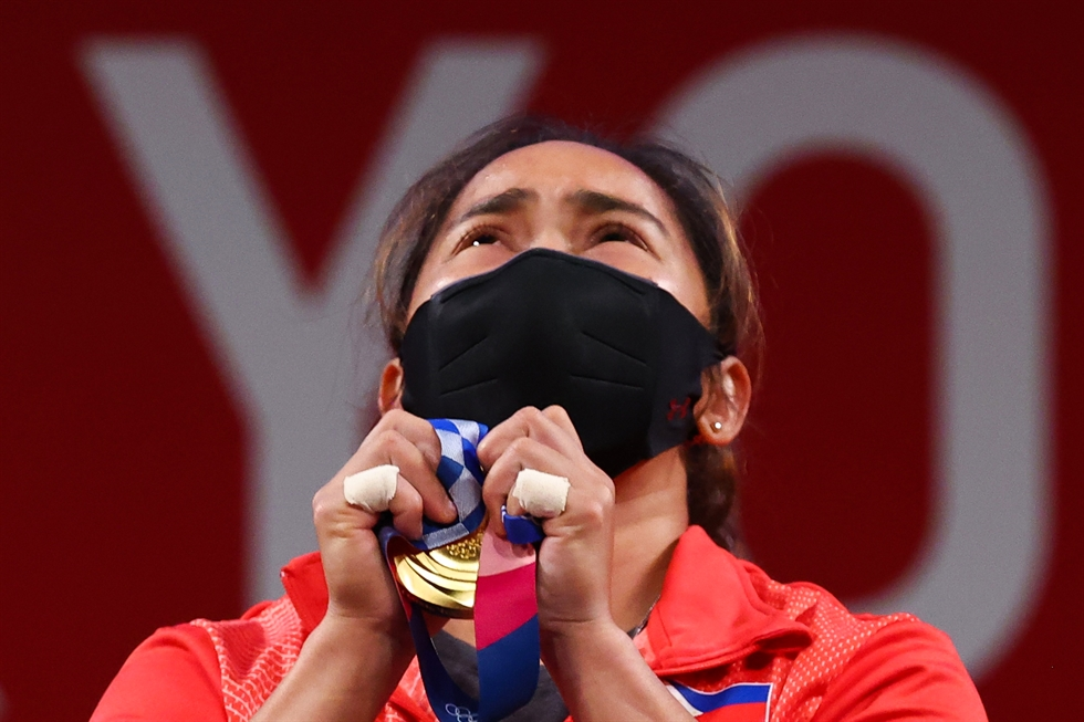 Hidilyn Diaz of Philippines celebrates as she competes and sets new world record and won the gold medal in the women's 55kg weightlifting event, at the 2020 Summer Olympics, July 26, in Tokyo. AP-Yonhap