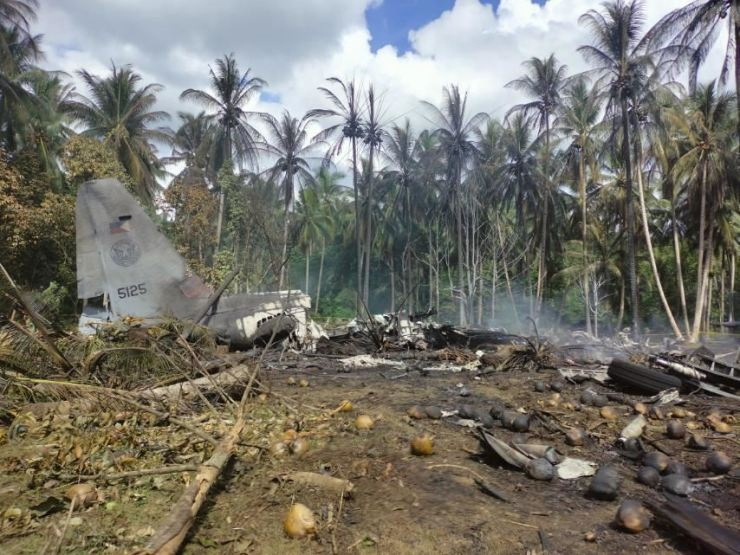 This photo released by the Joint Task Force shows the remains of a Philippine military C-130 plane that crashed in Patikul town, Sulu province, southern Philippines, July 4. AP-Yonhap