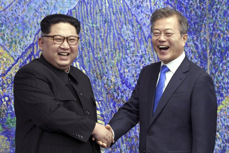 In this April 27, 2018, file photo, North Korean leader Kim Jong-un, left, poses with President Moon Jae-in inside the Peace House at the border village of Panmunjom in Demilitarized Zone, South Korea. AP-Yonhap