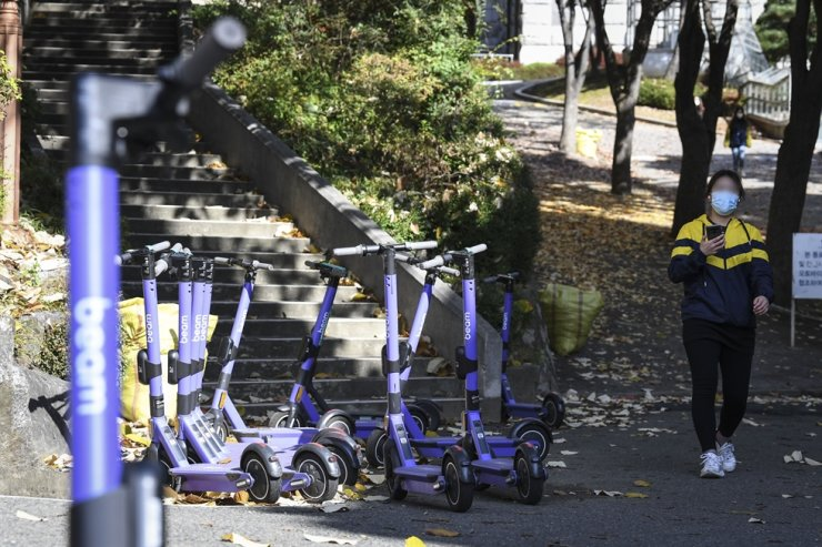 Electric scooters are parked on Yonsei University campus, Seoul, in this Nov. 3, 2020 file photo. Korea Times photo by Lee Han-ho