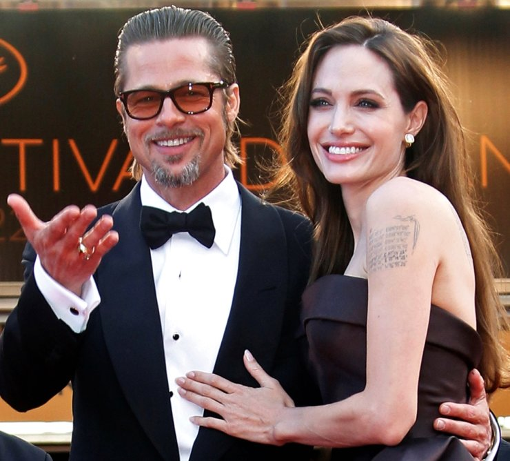 Angelina Jolie arrives with Brad Pitt on the red carpet for the screening of the film 'The Tree of Life,' by director Terrence Malick, in competition at the 64th Cannes Film Festival in this May 16, 2011, file photo. Reuters-Yonhap