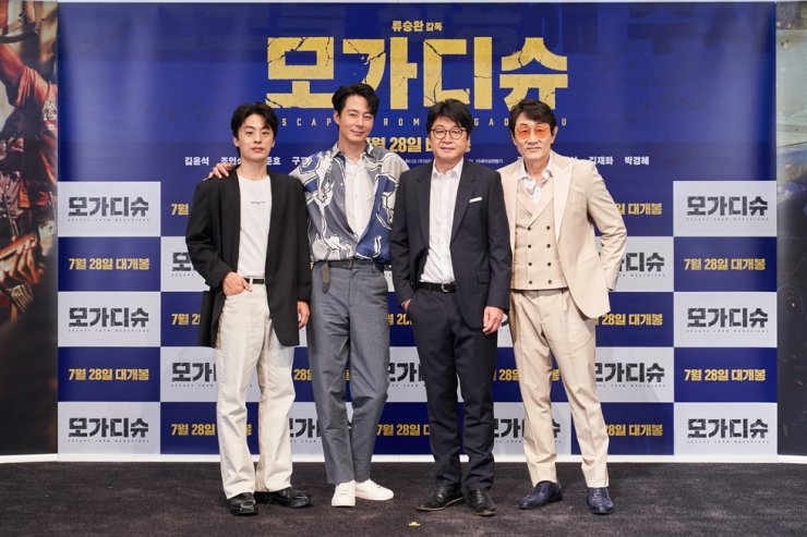 Actors Koo Kyo-hwan, from left, Zo In-sung, Kim Yun-seok, and Huh Joon-ho pose for pictures during a media conference to promote the film 'Escape from Mogadishu,' held in Lotte World Tower, Songpa-gu, eastern Seoul, Thursday. Courtesy of Lotte Entertainment