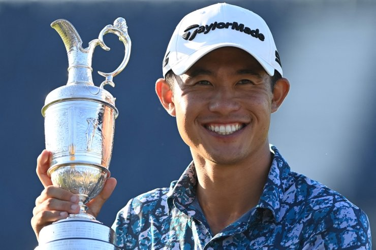 U.S. golfer Collin Morikawa poses for pictures with the Claret Jug, the trophy for the Champion Golfer of the Year, after winning the 149th British Open Golf Championship at Royal St George's, Sandwich in south-east England, July 18. AFP-Yonhap