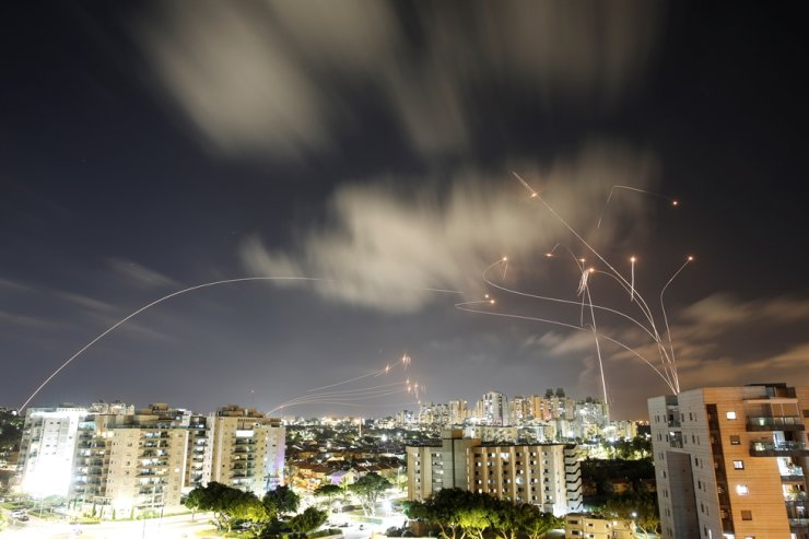 Streaks of light are seen as Israel's Iron Dome anti-missile system intercepts rockets launched from the Gaza Strip toward Israel, as seen from Ashkelon, Israel, May 12. On June 28, the South Korean military announced that it would launch a project to develop a South Korean version of the Iron Dome system next year, aiming to complete it by around 2035. Reuters-Yonhap