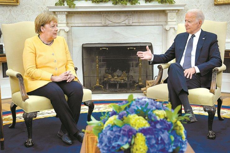 U.S. President Joe Biden meets with German Chancellor Angela Merkel in the Oval Office of the White House in Washington, July 15. AP-Yonhap