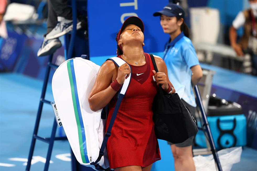 Naomi Osaka of Japan reacts after a point against Marketa Vondrousova of the Czech Republic during the women's singles third round tennis events of the Tokyo 2020 Olympic Games at the Ariake Coliseum in Tokyo, July 27. EPA-Yonhap