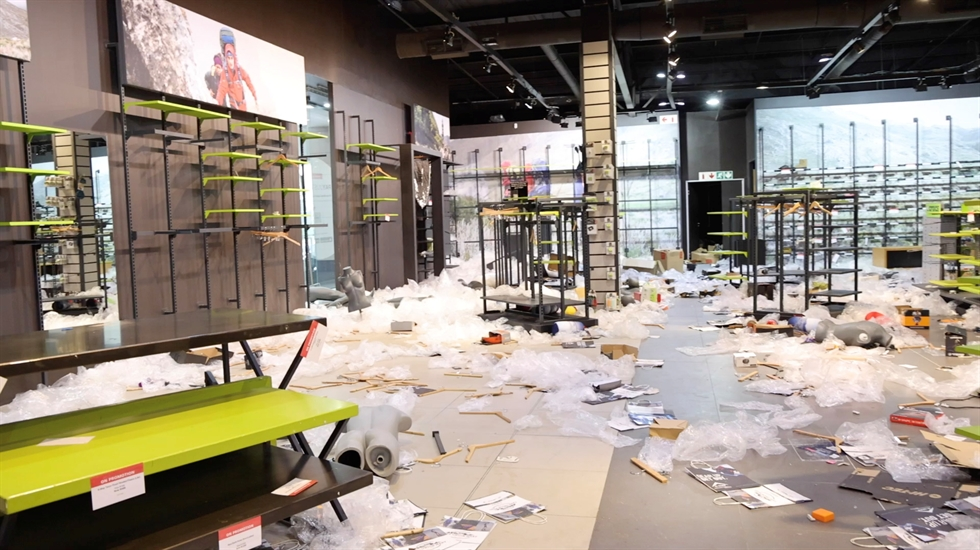 A member of the military walks as he inspects the damage at the looted Jabulani mall as the country deploys army to quell unrest linked to the jailing of former President Jacob Zuma, Soweto, South Africa, July 13. Reuters-Yonhap