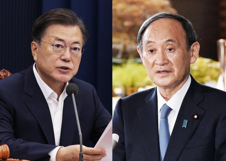 President Moon Jae-in, left, and Japan's Prime Minister Yoshihide Suga / Yonhap