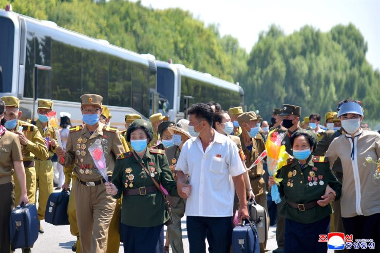Korean War veterans arrive in Pyongyang, July 25, to attend the 7th National Conference of War Veterans, North Korea's state media reported July 26.
