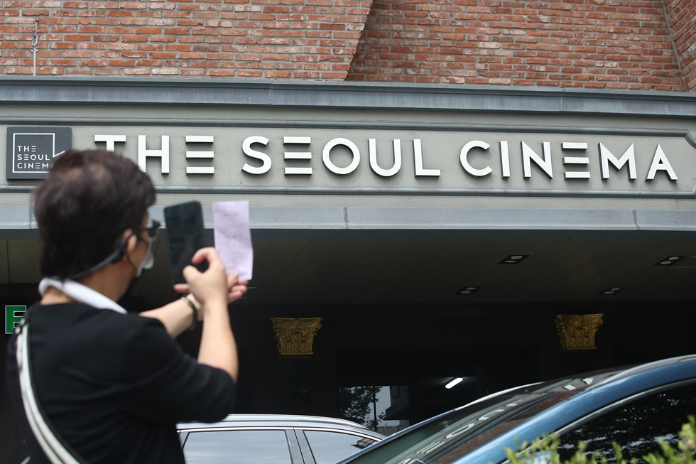 In this Sept. 17, 1978 file photo, people stand outside waiting to purchase tickets for 'The Last Winter' (1978) at the cinema then known as Theater Seoul, on its first day of business. Courtesy of The Seoul Cinema
