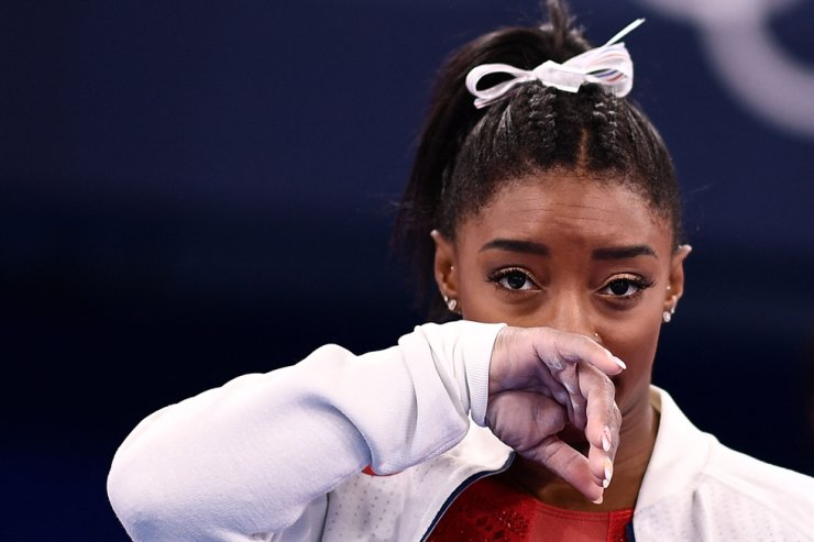 In this July 27 file photo, USA's Simone Biles gestures during the artistic gymnastics women's team final during the Tokyo 2020 Olympic Games at the Ariake Gymnastics Center in Tokyo. AFP-Yonhap