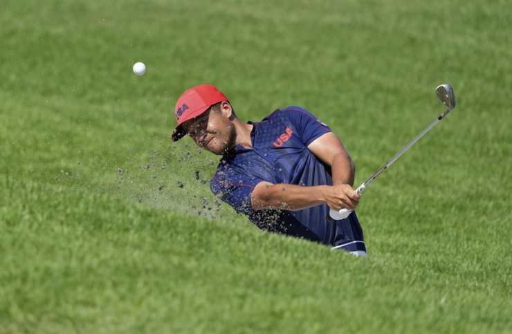 Xander Schauffele of the United States plays a shot from a bunker on the 12th hole during the final round of the men's golf event at the 2020 Summer Olympics in Kawagoe, Japan, Aug. 1. AP-Yonhap