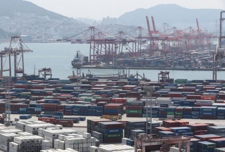 In this July 1 file photo, containers are piled at the Port of Busan. Yonhap