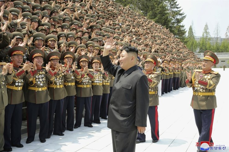 In this photo provided by the North Korean government, North Korean leader Kim Jong-un waves to participants in a workshop of the commanders and political officers of the Korean People's Army, in Pyongyang, North Korea, July 27. AP-Yonhap