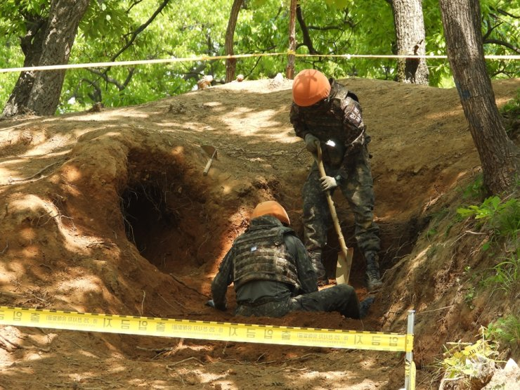In this file photo provided by the defense ministry on June 1, South Korean troops work to discover underground positions believed to have been used by soldiers during the Korean War inside the Demilitarized Zone. Yonhap