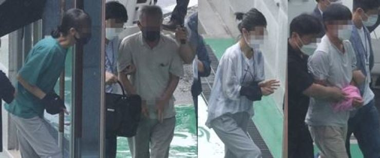 This combined photo shows four South Korean activists entering the Cheongju District Court, about 140 kilometers south of Seoul, to attend an arrest warrant hearing on Aug. 2 for allegedly taking orders from North Korea to stage anti-weapons protests. Yonhap