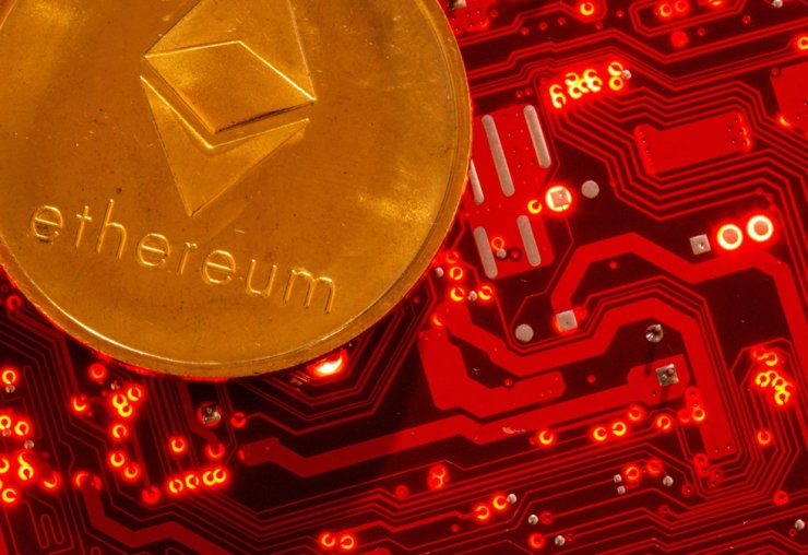 Representation of cryptocurrency Ethereum is placed on a PC motherboard in this image, June 29. Reuters-Yonhap