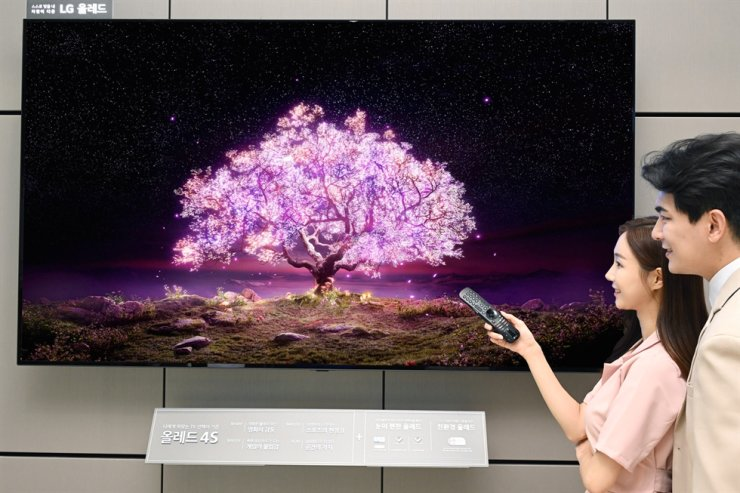 In this June 20 file photo, models promote LG Electronics' 83-inch OLED TV. Courtesy of LG Electronics