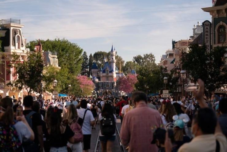 In this April 30 file photo, Disneyland in California is crowded with visitors. AP-Yonhap