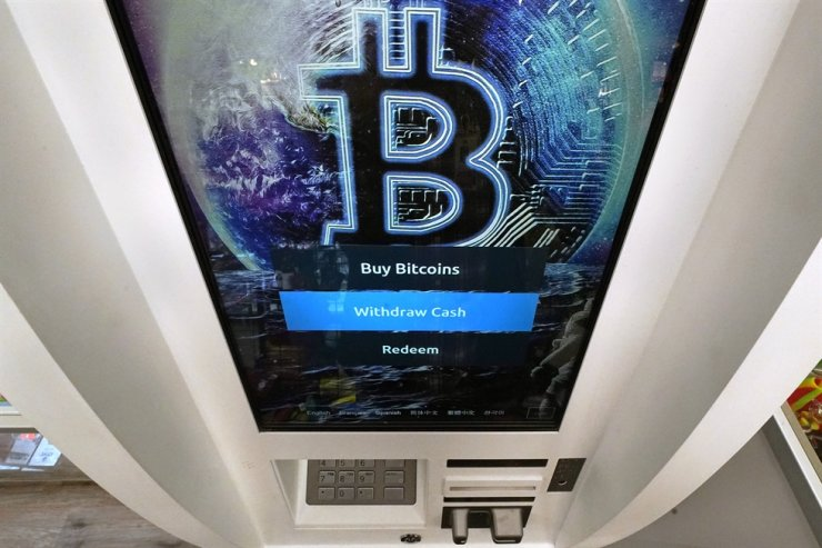 In this archive photo, the Bitcoin logo appears on the display screen of a cryptocurrency ATM last week.  AP-Yonhap