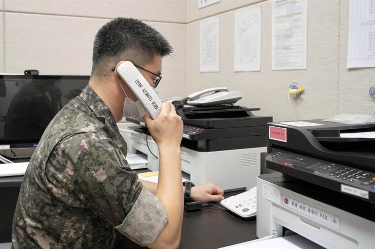 In this July 27 photo, a South Korean service member uses the inter-Korean western military communication line. Yonhap
