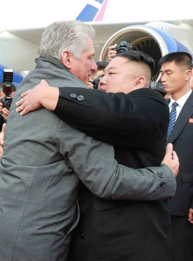 In this 2018 November file photo released by North Korea's Rodong Sinmun, North Korean leader Kim Jong-un and Cuban President Miguel Diaz-Canel hug each other at Pyongyang International Airport. Yonhap