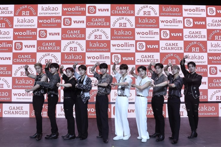 Members of K-pop act Golden Child pose during an online media event Monday. Courtesy of Woollim Entertainment