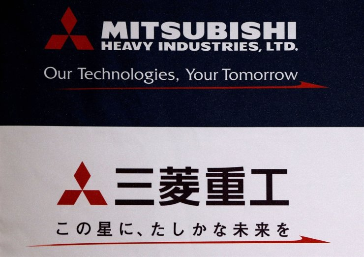 In this 2016 May file photo, the logo of Mitsubishi Heavy Industries is seen at the company's news conference. Reuters-Yonhap