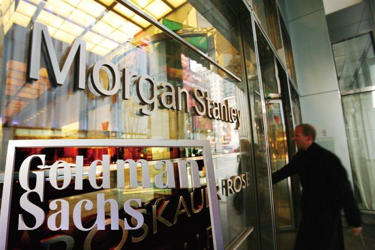 A man enters the Morgan Stanley building in New York in this file photo, while the Goldman Sachs logo is also seen at bottom-left. AP-Yonhap