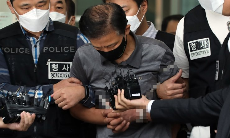 Kang Yoon-seong is escorted out of Songpa Police Station in southern Seoul, Sept. 7. Yonhap