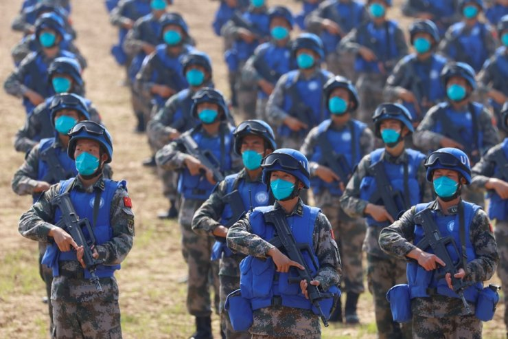 Soldiers of Chinese People's Liberation Army take part in a joint multinational U.N. peacekeeping military exercise with troops from Pakistan, Mongolia and Thailand, on the outskirts of Zhumadian, Henan Province, China, Sept. 15. Reuters-Yonhap