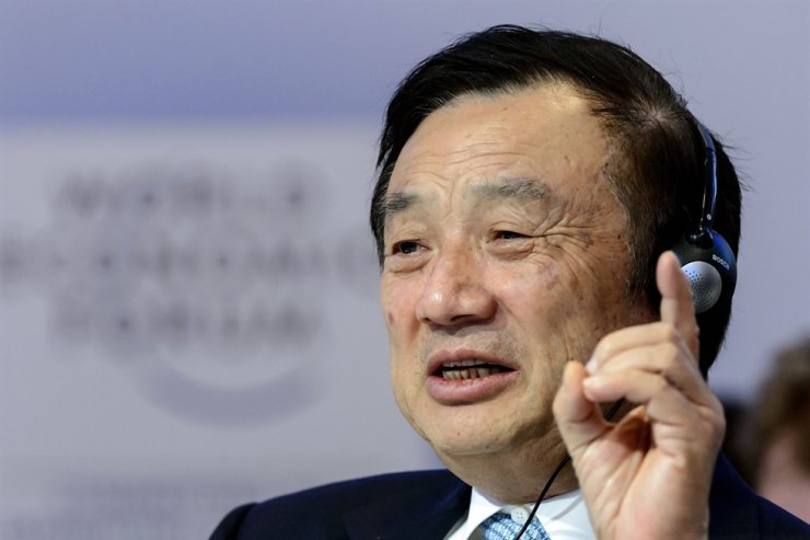 This file picture taken on Jan. 22, 2015, shows Huawei Founder and CEO Ren Zhengfei gesturing as he attends a session of the World Economic Forum annual meeting in Davos. AFP-Yonhap