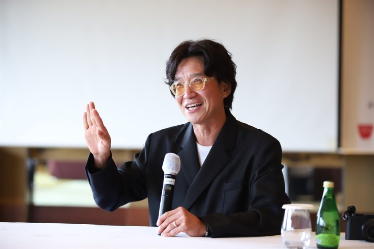 Photographer MJ Kim speaks during a media interview at the Grand Hyatt Seoul, Sept. 1. He was one of the panelists for the 2021 Culture Communication Forum (Aug. 31―Sept.1), an event organized by the Corea Image Communication Institute (CICI). Courtesy of CICI