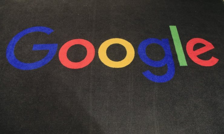 In this Nov. 18, 2019, file photo, the logo of Google is displayed on a carpet at the entrance hall of Google France in Paris. Google said Wednesday it offers around 12 trillion won ($10.25 billion) in economic benefits for Korean consumers annually through its services. AP-Yonhap