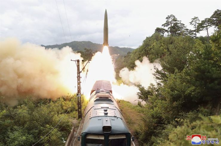 This photo released by North Korea's state-run Korean Central News Agency, Thursday, shows a missile test-launched from a train the day before in an undisclosed location in North Korea. Yonhap