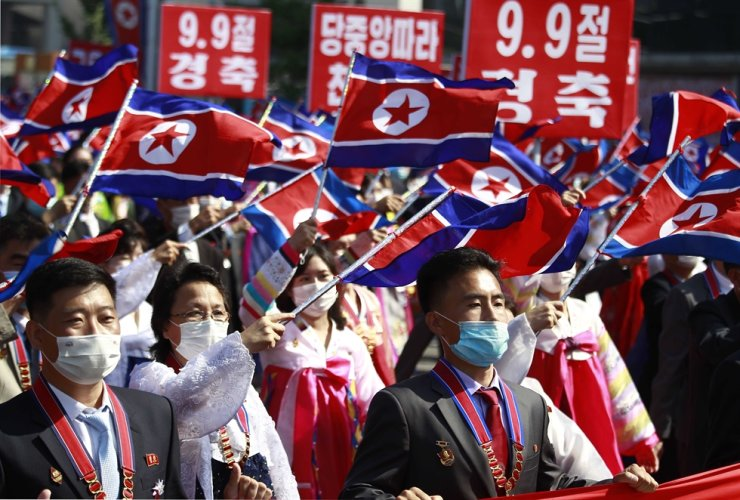 People wave the flags in a celebration of the nation's 73rd founding anniversary in Pyongyang, North Korea, Sept. 9. AP-Yonhap