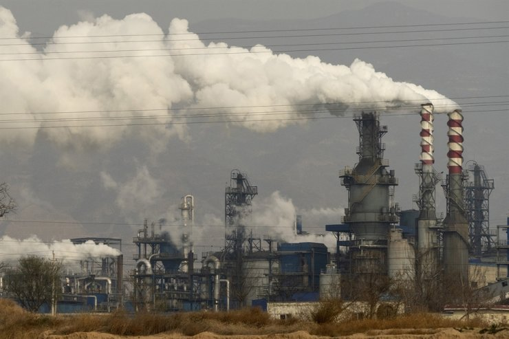 In this Nov. 28, 2019, file photo, smoke and steam rise from a coal processing plant in Hejin in central China's Shanxi Province. Global shoppers face possible shortages of smartphones and other goods ahead of Christmas after power cuts to meet government energy use targets forced Chinese factories to shut down and left some households in the dark. AP-Yonhap