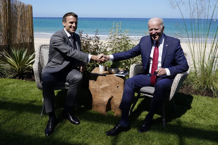 In this June 12 file photo, President Joe Biden and French President Emmanuel Macron shake hands during a bilateral meeting at the G-7 summit, in Carbis Bay, England. AP-Yonhap